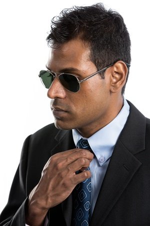 Indian business man wearing a suit and sunglasses. Isolated against a white background Stock Photo - 15162978