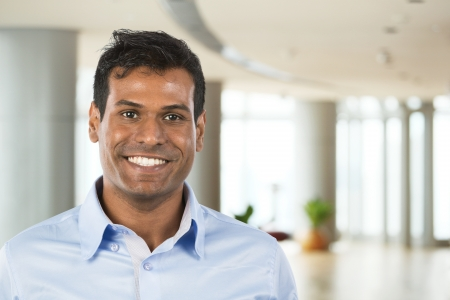 happy man: Happy Indian business man at the office. Stock Photo