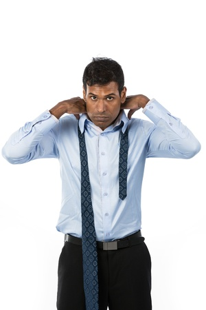 Indian businessman putting on his tie. The isolated white background