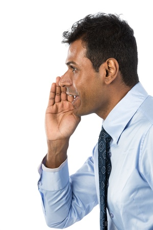 screaming face: Indian Business man shouting his message. Isolated against a white background.