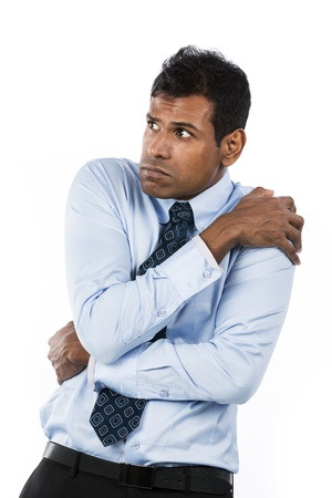 anguished: Scared Indian business man. Isolated on white background