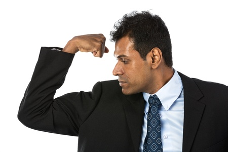Indian business man flexing his bicep. Concept about power and strength. photo