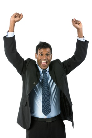 arm outstretched: Happy Indian business man celebrating his success.