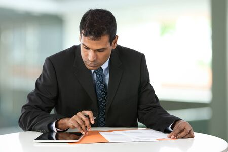 Portrait of an Indian business man working with his Digital Tablet. Stock Photo - 15162853