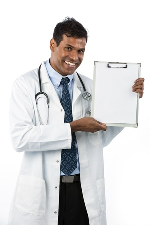 Happy Indian male doctor showing a clipboard. Isolated over a white background photo