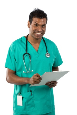 Male Indian doctor wearing a Green Scrubs & holding a clip board. Isolated on white background. photo