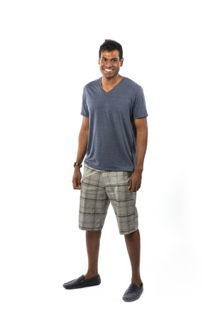 Full-length image of an Indian man wearing t-shirt & shorts. Isolated on White Background photo