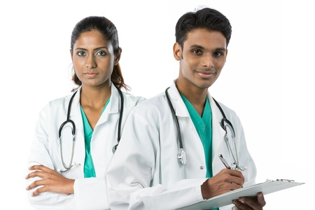 Asian doctor's wearing a green scrubs, white coat and stethoscope. photo