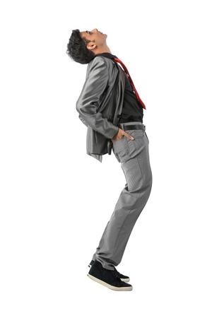 nonconformity: Indian Business man leaning backwards. Isolated on white background Stock Photo