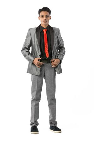 Fashionable young Indian man wearing a suit & tie. Isolated on white photo