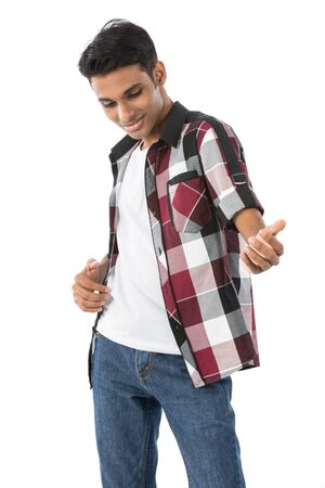 indian male: Portrait of a happy Indian man playing air guitar. Isolated against a white background. Stock Photo