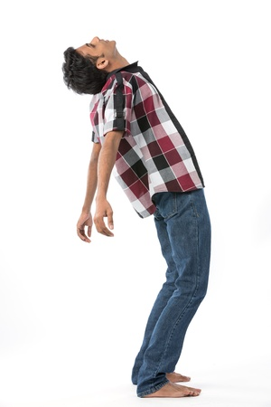 people looking up: Young Indian man leaning backwards. Isolated on white background