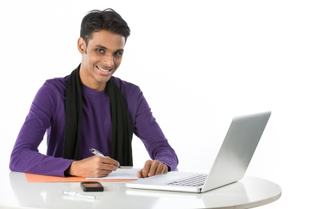 indian professional: Asian male student study at a desk with a laptop. Isolated on white. Stock Photo