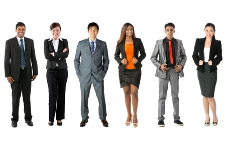 malaysian people: Full length Portrait of a multi-culural business team. Isolated on a white background. Stock Photo