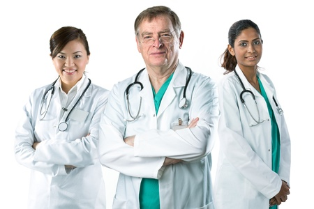 Portrait of a Mature male doctor standing with his team. photo