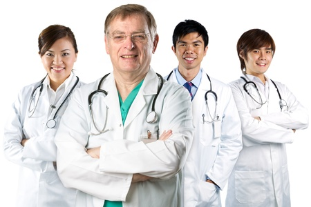 the only female: Four Asian doctor wearing a white coats with stethoscopes. Isolated on white. Stock Photo
