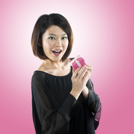 Happy Chinese girl with a gift in her hand photo
