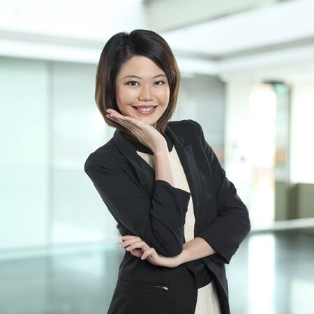 A cute looking chinese business woman. isolated white background photo