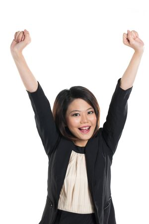 happy Chinese Business woman celebrating with her arms in the air. Isolated on a white background. photo