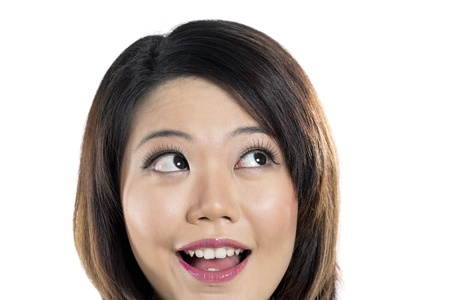 Closeup of beautiful Chinese woman looking up. Isolated on white background. Stock Photo