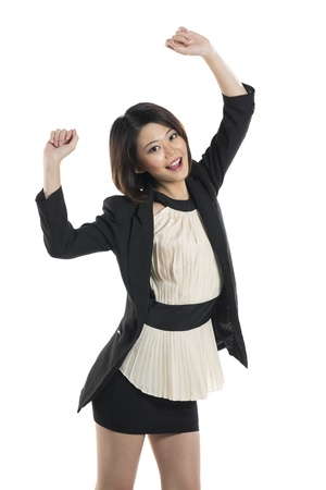 Very happy Chinese Business woman celebrating with arms in the air. Isolated on a white background. photo