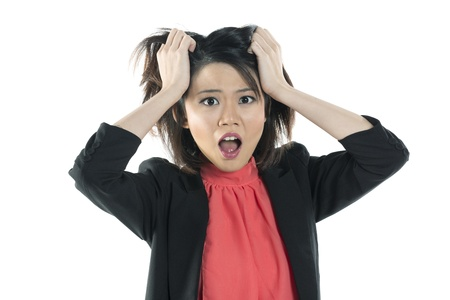 surprise face: Chinese business woman looking shocked and surprised. Isolated on white Stock Photo