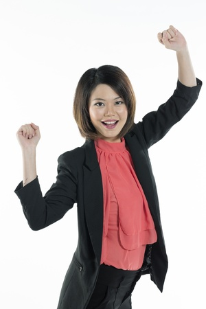 Portrait of Beautiful happy Chinese business woman celebrating. Isolated on white background. photo