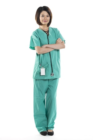 Chinese woman doctor wearing a green Scrubs and stethoscope. Isolated on white. Full length Portrait. Stock Photo - 16729124