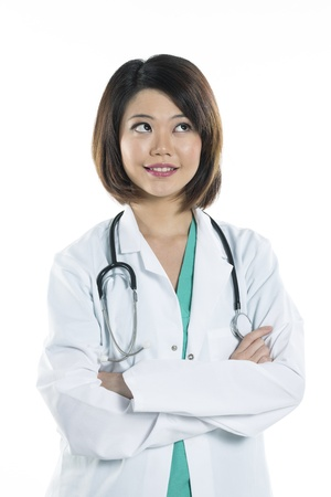 Portrait of a Female Chinese doctor looking up into the corner. Isolated on white. photo