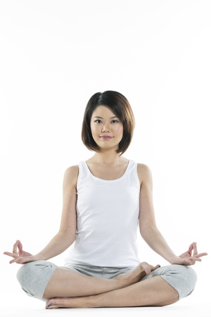 Portrait of a beautiful Chinese woman in Lotus yoga position. photo