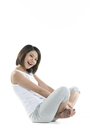 Happy & playful Chinese woman resting while doing exercise.  photo