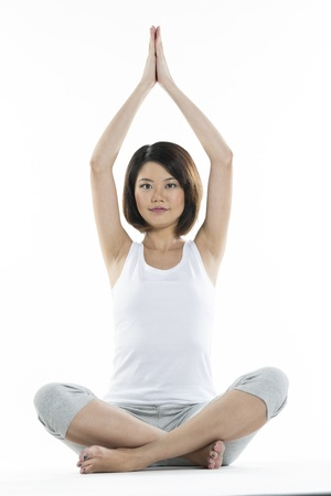 thai yoga: Portrait of a beautiful Chinese woman doing yoga exercise Stock Photo