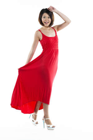 chinese dress: Happy Chinese woman wearing red summer dress. Energetic full length portrait of a young beautiful woman. isolated on white background.  Stock Photo