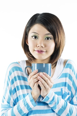 espresso cup: Young Chinese woman holding a coffee mug. Isolated on white background