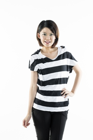 composed: A gorgeous young Chinese woman wearing casual clothes. Isolated on a white background
