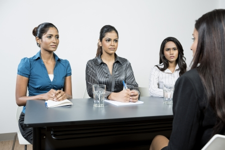 indian blue: Three Indian colleagues from hr department interview a female applicant Stock Photo