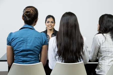 applicant: Three Indian colleagues from hr department interview a female applicant Stock Photo