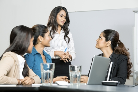 asian office lady: Group of happy Indian business women in a meeting at office