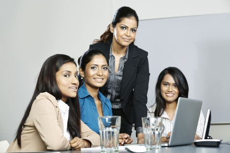 Indian business women working together on a project photo