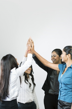 south india: Indian Business team celebrating with a high five.