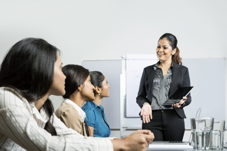 south asian: Indian business woman giving presentation with her digital tablet.