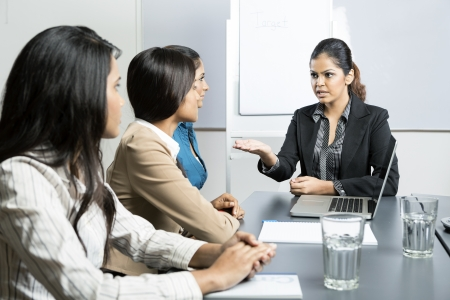 angry boss: Angry boss talking with her team during a meeting. Indian business woman.