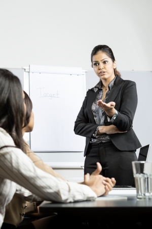 Angry Indian business woman talking to her staff during a meeting. photo