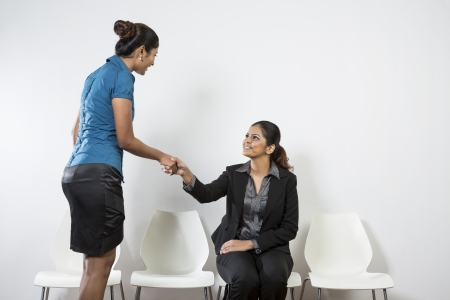 Happy Indian business woman shaking hands. Woman ready for job interview or meeting. photo