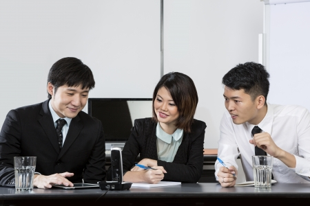 conference call: Chinese Business team having a conference phone call