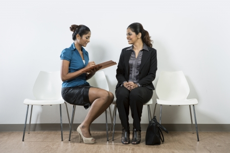 interviewing: Indian woman from hr department interview a female applicant.