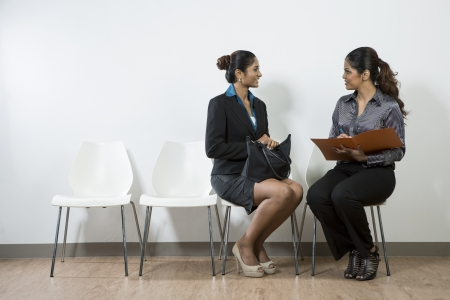 applicant: Indian woman from hr department interview a female applicant.