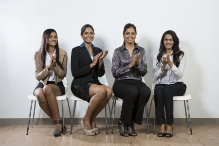 Team of Indian business women applauding good news photo