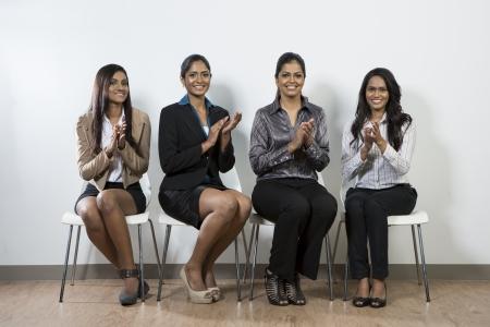 Team of Indian business women applauding good news