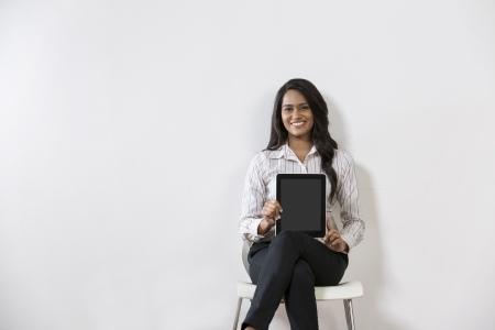 east indians: Beautiful Indian business woman holding a digital tablet computer.